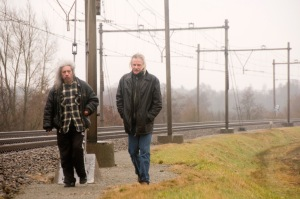 Jan Beckers met dhr. J. Ririmasse, met op de achtergrond de plek waar het allemaal gebeurde, De Punt